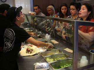 Chipotle urges sick workers to stay home