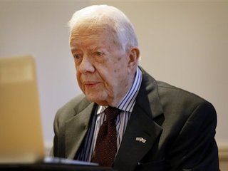 Jimmy Carter says scans show no signs of cancer