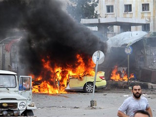 IS claims deadly blasts in 2 Syrian cities
