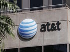 AT&T to cut data overage charges