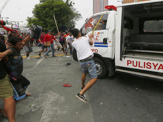 Philippine police van rams protesters
