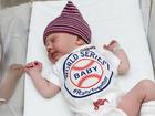 Indians get boost from newborn babies in onesies