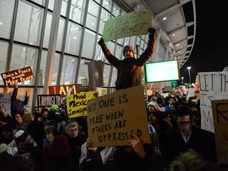 PHOTOS: Hundreds protest Trump's immigration ban