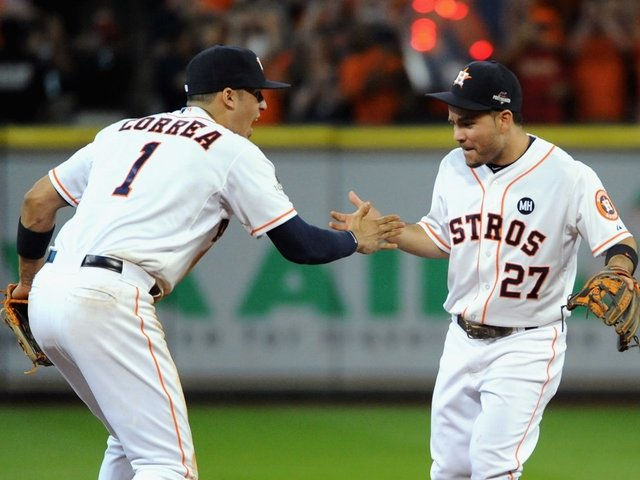 Astros return to Houston, providing diversion to deluged city