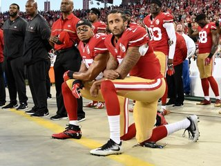 Chiefs fans react as NFL players protest