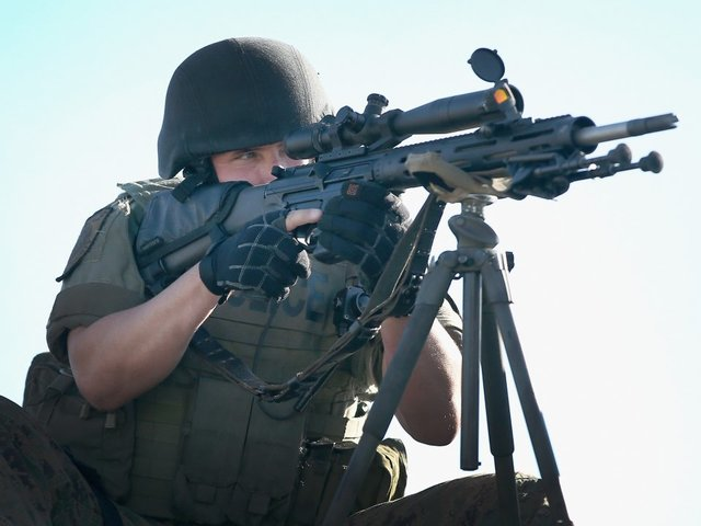 Trump lifts ban on military gear for police