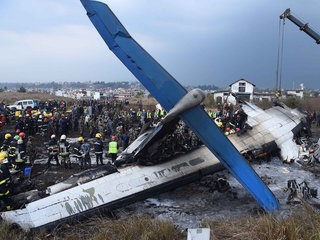49 dead after plane crashes at Nepali airport