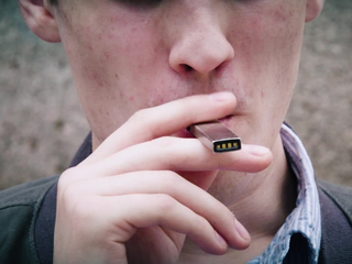 E-cig warnings going in high school bathrooms