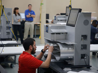 Florida county collects uncounted ballots